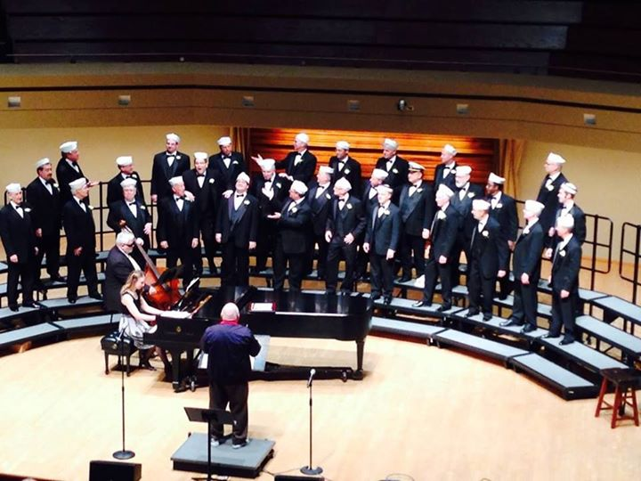 Naperville Mayor George Pradel conducts the Glee Club at its 25th Anniversary Concert